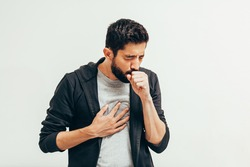 Sick man coughing over his hand. Coronavirus, covid-19 concept