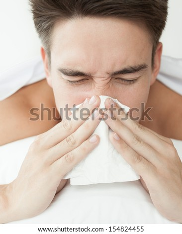 Sick man. Flu. Man caught cold. Virus.