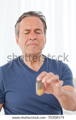 Sick man taking his pills at home