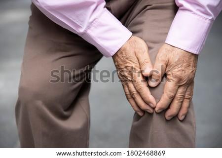 sick old senior man suffering from knee pain, knee joint injury, gout, rheumatoid, arthritis, osteoporosis