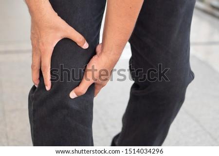 sick old senior man suffering from knee pain, knee joint injury, gout, rheumatoid, osteoporosis