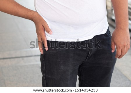 sick old senior man suffering from pelvis or pelvic joint pain, hip stiffness, gout, rheumatoid, osteoporosis