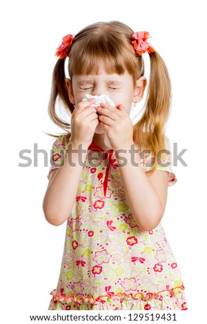 sick or crying child wiping or cleaning nose with tissue isolated