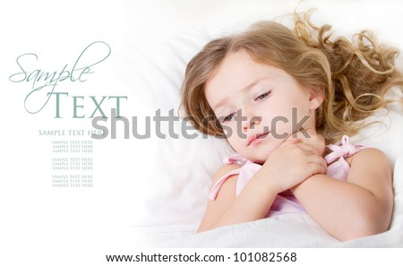 Sick or Sad child preschool age in bed on white background