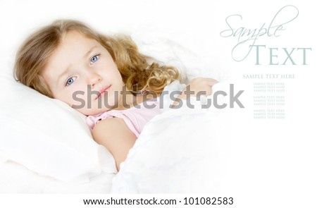Sick or Sad child preschool age in bed on white background - stock photo