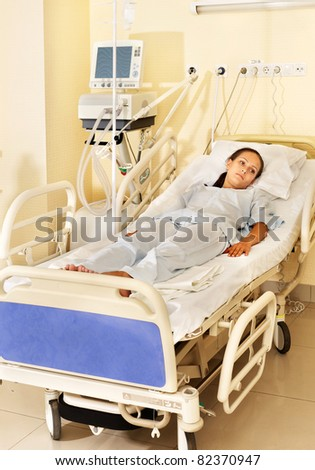 Sick patient on gurney in operating room.
