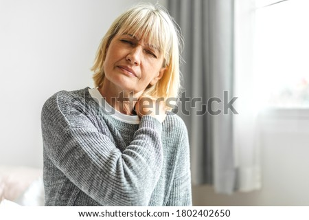 Sick senior adult elderly women touching the neck have shoulder and neck pain.Healthcare and medicine concept Stock photo ©