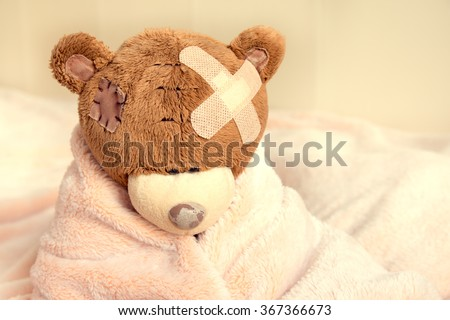 sick teddy bear with patch in...