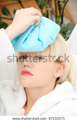 Sick woman at home with terrible headache