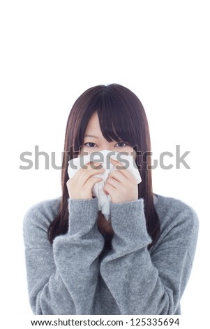 Sick woman blowing her nose isolated on white background