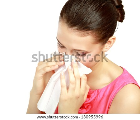 Sick woman blowing her nose, white background