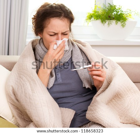 Sick Woman.Flu.Woman Caught Cold. Sneezing into Tissue. Headache. Virus