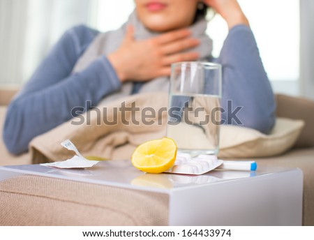 Sick Woman. Flu. Woman Caught Cold. Sneezing into Tissue. Headache. Virus. Medicines