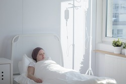 Sick woman is lying in a hospital bed