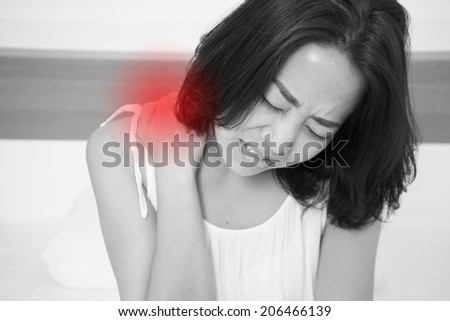 sick woman on bed concept of back pain,stomachache, headache, hangover, sleeplessness or insomnia with red alert accent Stok fotoğraf ©