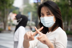 sick woman wearing mask, stopping virus outbreak; concept of biohazard, preventive health care, coronavirus outbreak control, social distancing, physical distancing, personal distancing in public