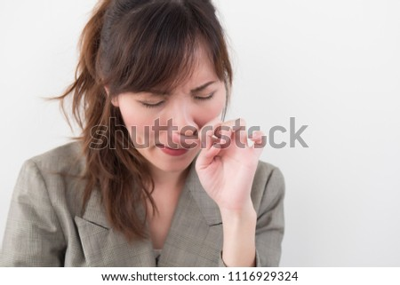sick woman with runny nose portrait; sick asian casual woman with runny nose, cold, flu, illness,  contagious disease, health care concept; young adult asian woman model
