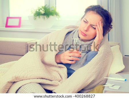 Sick Woman with Thermometer. Allergy reaction. Flu.Woman Caught Cold. Sneezing into Tissue. Headache. Virus. Flue