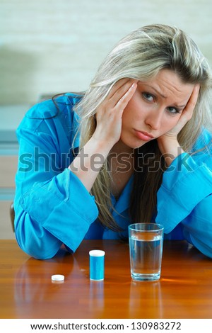Sick young woman with pills