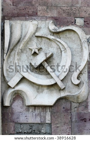 Sickle and hammer old dusty tile building decoration