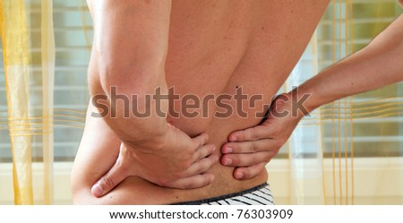Sickness caused by pain in the back. Intervertebral disc and spinal column.