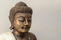 Siddhartha bronze statue. Close up of Buddha beautiful serene face with closed eyes. Best meditation inspiration image or mindfulness background.Copy space.