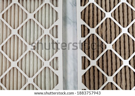 Side by side close up view of a new unused and an old heavily clogged dirty air filters. Image emphasizes the role of framed filters in improving air quality and preventing respiratory problems. Photo stock ©