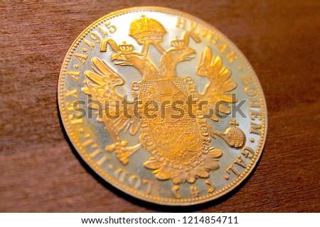 Side Close Up on Wood, Austria-Hungary thalers, back of golden coin-ducat,  1915, Kaiser Franz Joseph I, LOD ILL REX A A 1915 HVNGAR BOHEM GAL