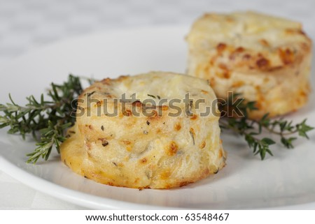 Side dish of potato souffle with rosemary and thyme.
