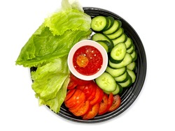 Side dishes contains raw salad leaves, slices of cucumber and tomatoes with hot sambal sauce (top view - isolated on white background).