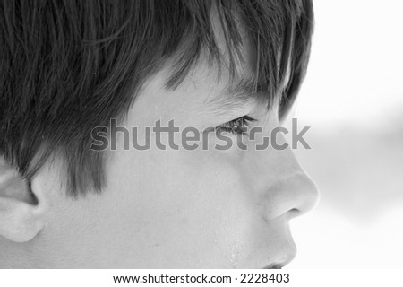 Side face of young teenage boy on the beach.