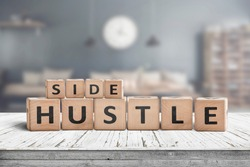 Side hustle sign on a plank table in a decorative room with a clock