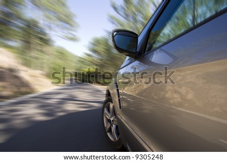side of a car with speed blur