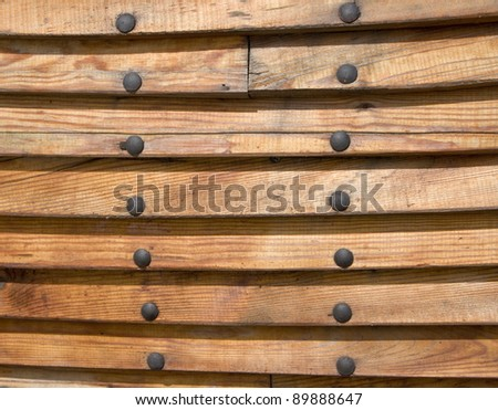 side of boat from wooden laths with nails