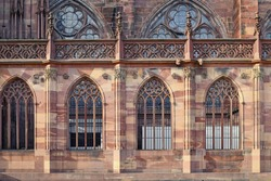Side of famous Strasbourg Cathedral in France with arch windows in romanesque and gothic architecture style
