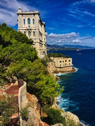 Side of Oceanographic Museum of Monaco in Monte Carlo with Turquoise Ocean Water and Green Tree. Marine Institut in Monaco.