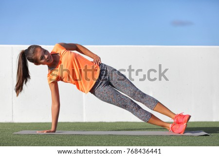 Side plank fitness woman training body core planking exercise. Workout at outdoor gym or home garden Asian girl exercising obliques abs muscles with yoga pose plank. #768436441