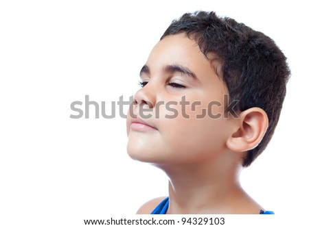 side portrait of a latin boy looking up isolated on white with space for text