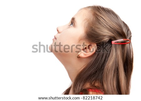 Side portrait of a latin girl looking up with hope isolated on a white background