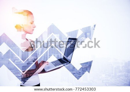 Side portrait of attractive young woman using laptop on abstract light city background with arrows. Technology and success concept. Double exposure