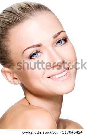 Side portrait of beautiful smiling woman with clean face - isolated on white