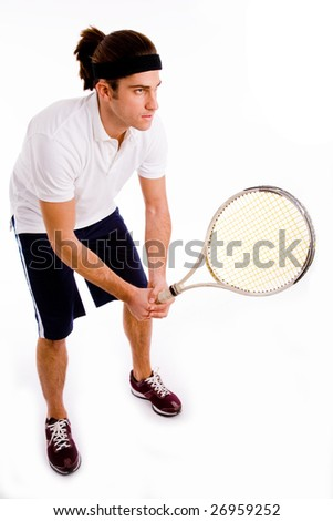 side pose of young tennis player against white background