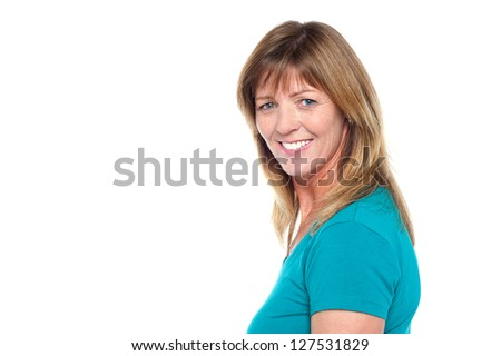 Side profile of a middle aged female model in casuals against white background.