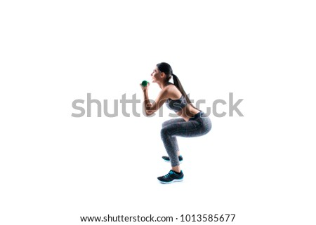 Side profile view photo of beautiful attractive smiling confident young slim slender strong woman trainer doing crouching exercises and holding dumbbells in hands, copyspace