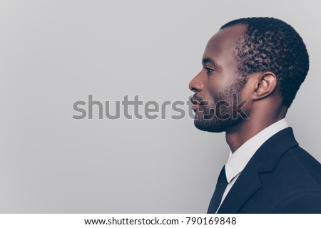 Side profile view portrait of smart experienced qualified clever strict head on big company clothed in black jacket and white shirt looking aside isolated on gray background copyspace