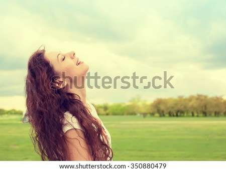 Side profile woman smiling looking up to blue sky celebrating enjoying freedom. Positive human emotion face expression feeling life perception success, peace of mind concept. Free happy girl