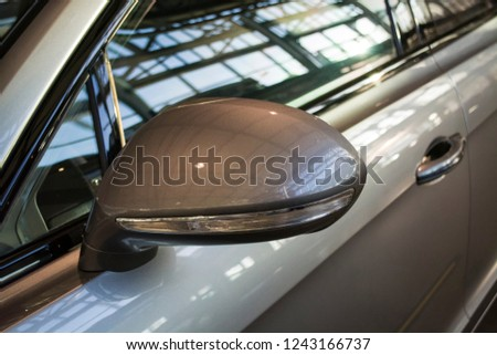 Side rear-view mirrors on the gray sports car. #1243166737