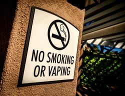 "Side shot of a ""no Smoking or Vaping"" sign"