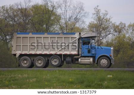 Side Shot of Dumptruck on the highway