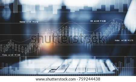 Side view and close up of laptop placed on desktop with abstract forex chart. Trade and finance concept. Double exposure